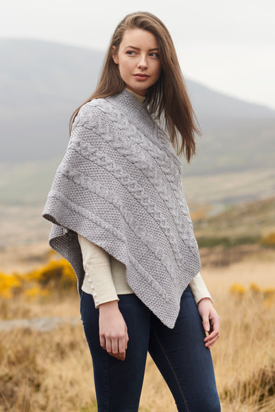 LADIES ARAN PONCHO WITH CABLE AND MOSS STITCHING