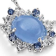 Blue cats eye stone surrounded by cubic zirconia's in clear and lilac set in sterling silver