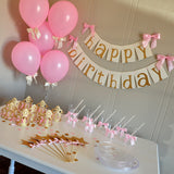 Pink and Gold Essentials Party Package. Ships in 1-3 Business Days. Balloons, Crowns, Straws, Cups, Plates, Wands, Confetti and Banner.