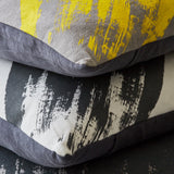 Geometric brushstroke cushion - yellow/grey