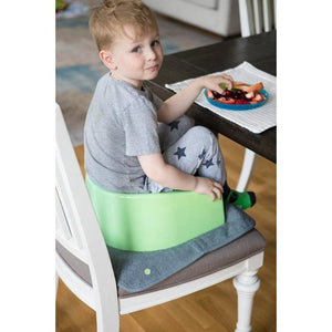 PeapodMats washable, reusable waterproof 1.5'x1.5' chair pad for bed wetting and incontinence, product illustration in dark grey with toddler; mat protects seat during meals