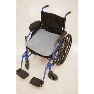 PeapodMats washable, reusable waterproof 1.5'x1.5' chair pad for bed wetting and incontinence, product illustration showing dark grey mat in wheelchair