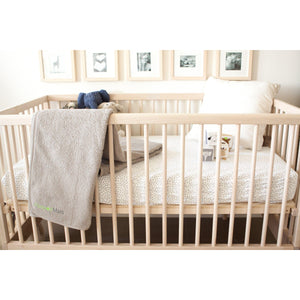 3'x'5 Sand Taupe PeapodMats Washable & Reusable Waterproof Bed Wetting Incontinence Mats on floor under hanging over crib side