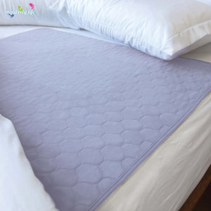 Bed wetting solution: Conni Mate Bed Pad with Waterproof Barrier in mauve