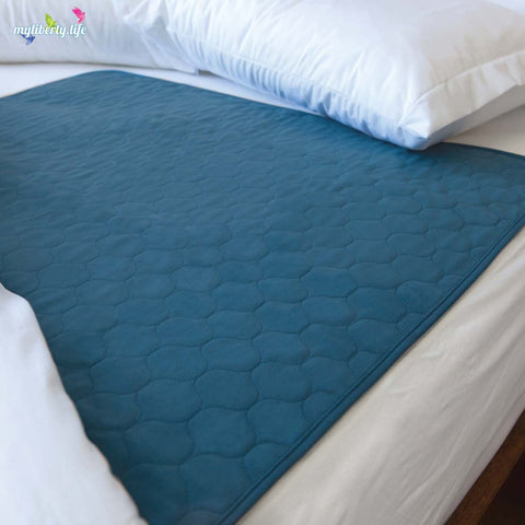 Bed wetting solution: Conni Mate Bed Pad with Waterproof Barrier in teal blue