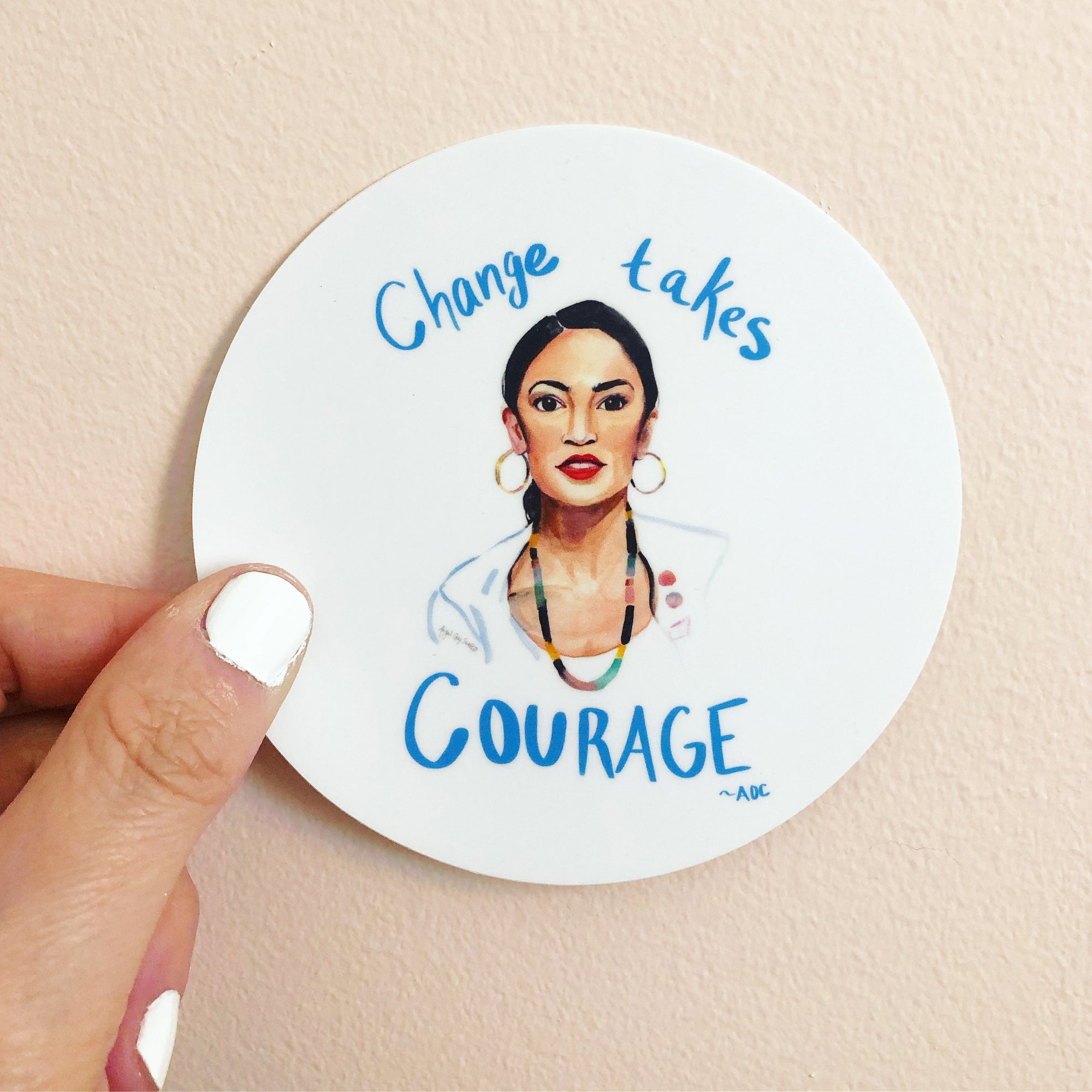 "AOC portrait sticker, quoted ""Change takes courage"""