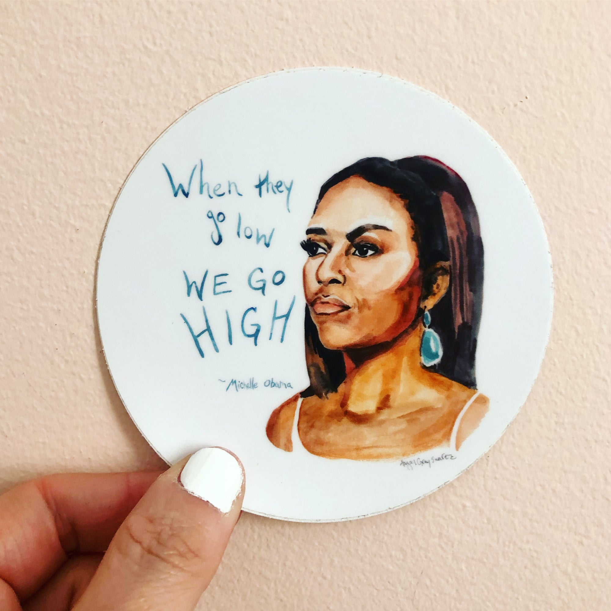 "Michelle Obama portrait sticker, inspiring quote ""When they go low, we go high"" by Abigail Gray Swartz"