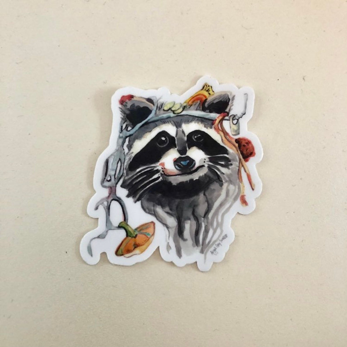 Dumpster Diver sticker of raccoon face by GrayDayStudio
