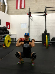Rodney squatting with his new Oly Bar!
