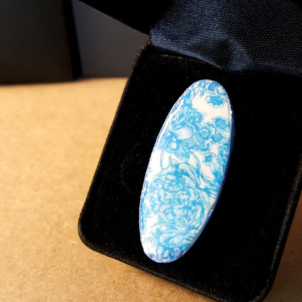Oval Shaped Blue Ring