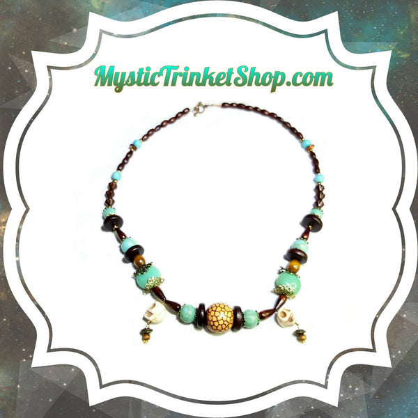 Necklace - Wood And Turquoise Colored Tribal Skull Necklace