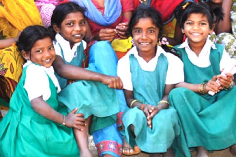 Happy school children of organic cotton farmers