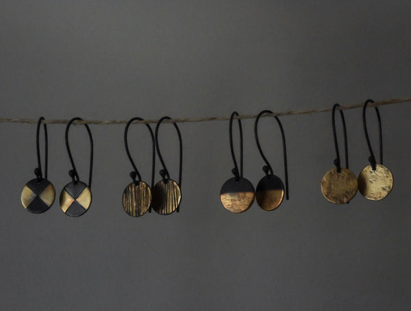 group view of dot dangle earrings hanging up