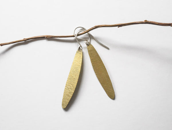 view of hand made textured simple leaf earrings, made of brass with sterling ear wires