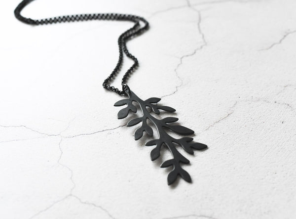 angle view of black leaves sterling silver necklace