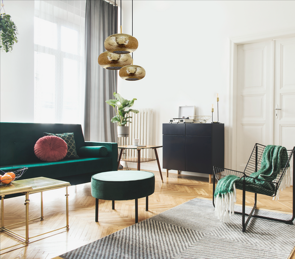 Lila chandelier by dounia home in brass pendant cluster hand made green velvet couch and chair mid-century modern livingroom