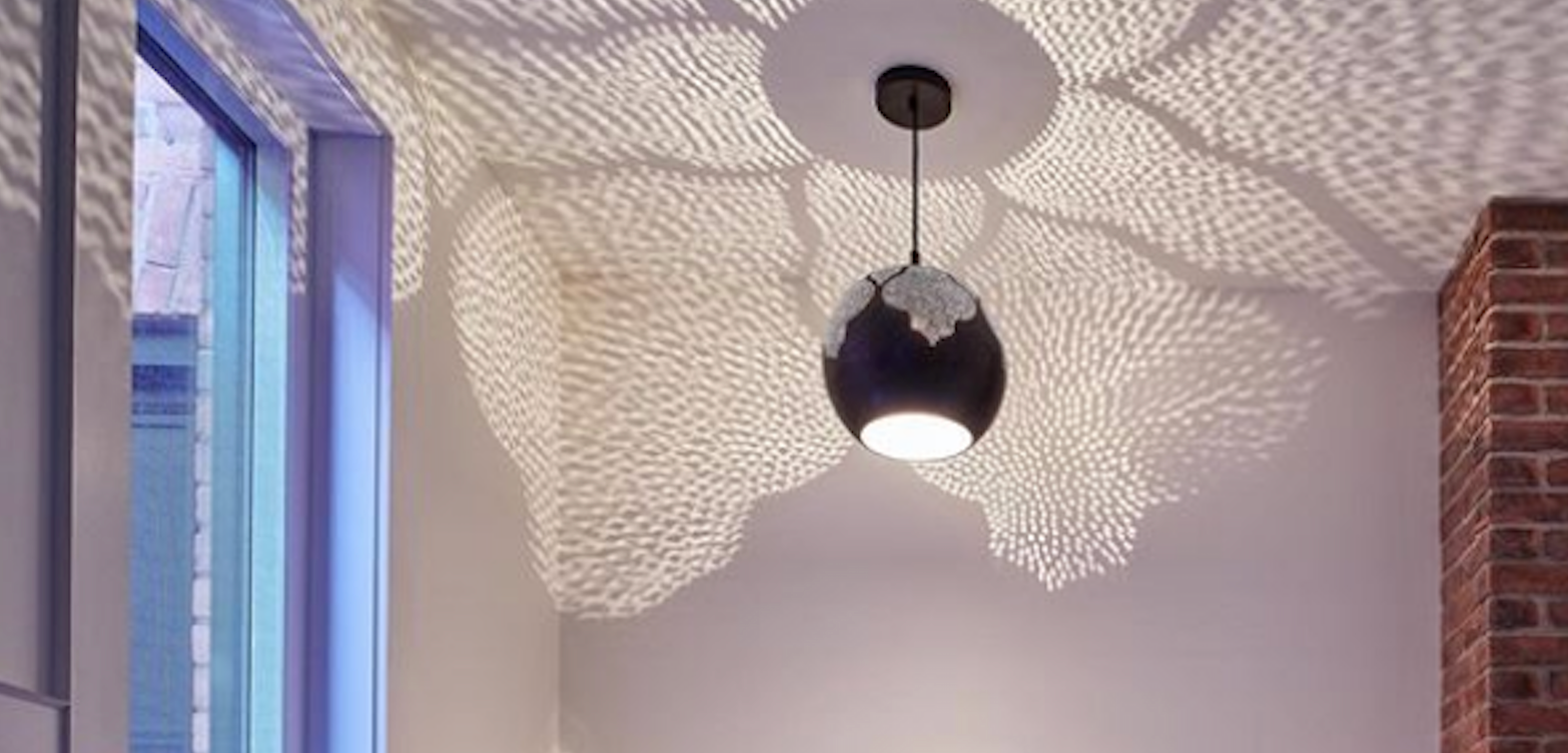 moroccan shadow casting light  by dounia home najma trellis bedroom bathroom