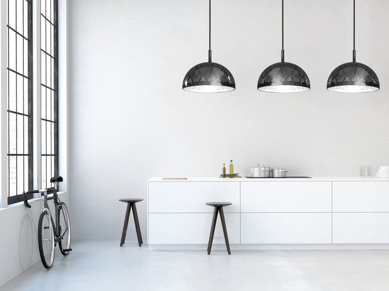 pierced metal pendant light by dounia home pendant light in a modern kitchen