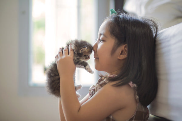 Girl Kissing Kitten