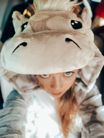 girl's selfie of a giraffe costume head blue eyes