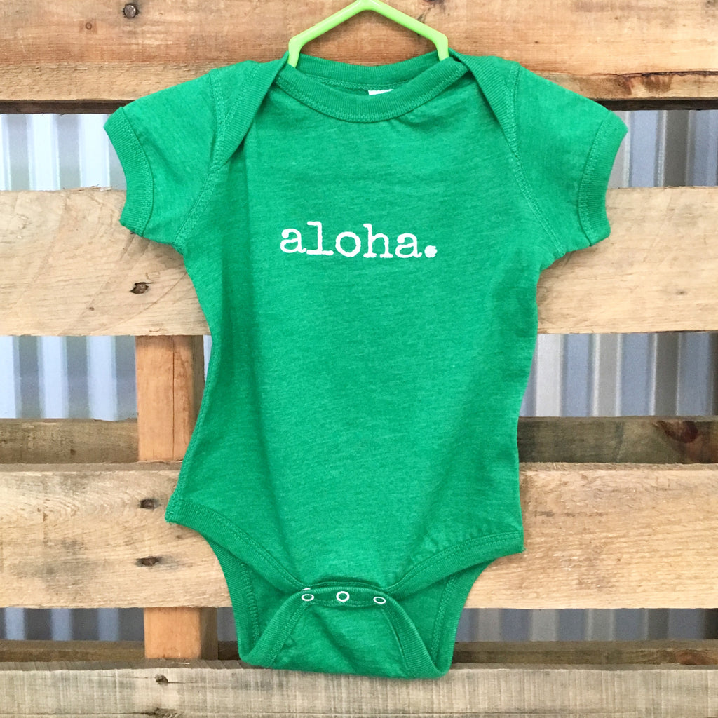 kelly green gender neutral baby Ivy & Co. onesie with white writing that says aloha