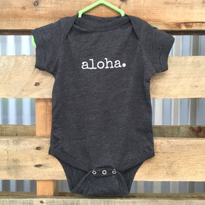 dark grey gender neutral baby Ivy & Co. onesie with white writing that says aloha