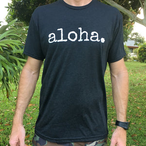 man with watch wearing a black tshirt that says aloha in white font