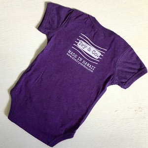 purple baby girl onesie with white Ivy & Co postage stamp logo