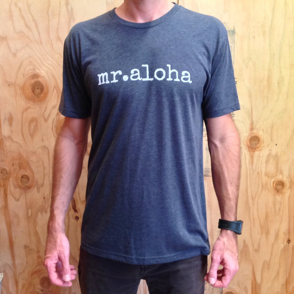man with watch wearing a blue tshirt that says mr. aloha in white font