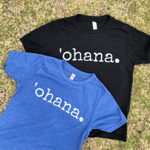 two tshirts laying on the grass with the word 'ohana on them