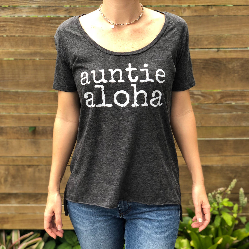 woman wearing a dark grey auntie aloha scoop neck tshirt with choker necklace