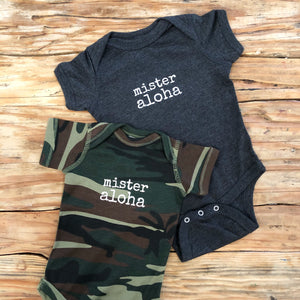 vintage navy and camouflage baby onesie with white lettering that says mister aloha