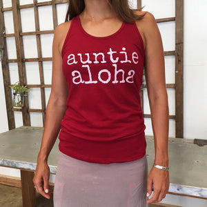 woman wearing a red auntie aloha racer back tank top with pink skirt