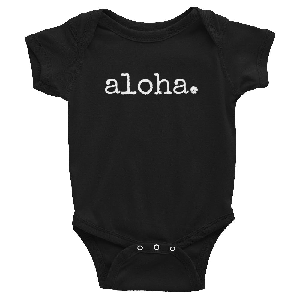 black gender neutral baby Ivy & Co. onesie with white writing that says aloha