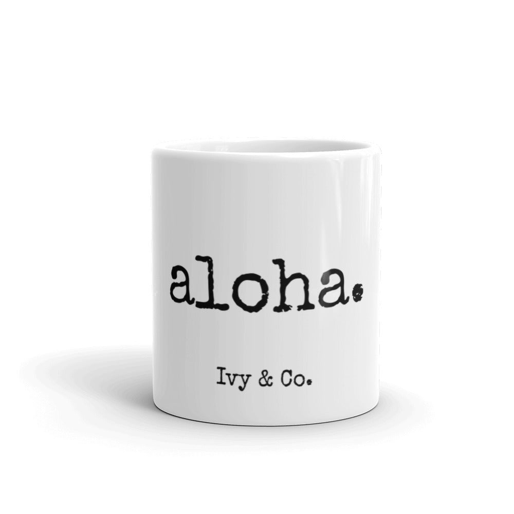 white mug with black font that says aloha