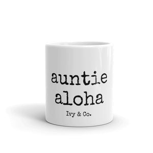 white mug with black font that says auntie aloha