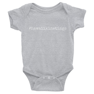grey baby onesie with white lettering that says hawaiikinetings