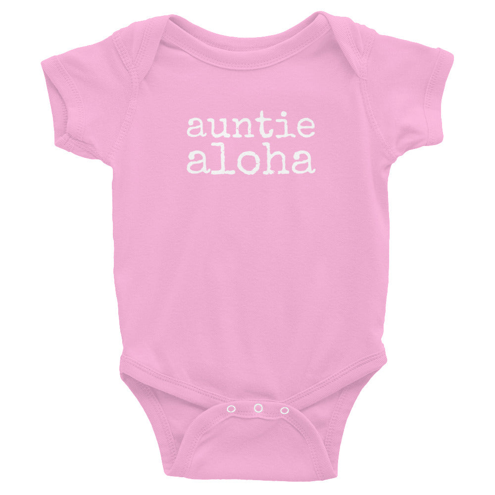 pink baby girl Ivy & Co. onesie with white writing that says auntie aloha
