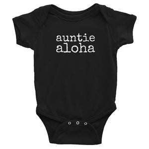 black baby girl Ivy & Co. onesie with white writing that says auntie aloha