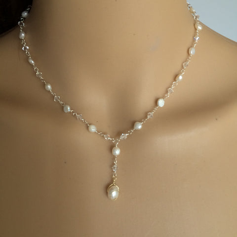 Swarovski Crystal and Freshwater Pearl necklace - Capture my heart from sherocksbridaljewellery.com