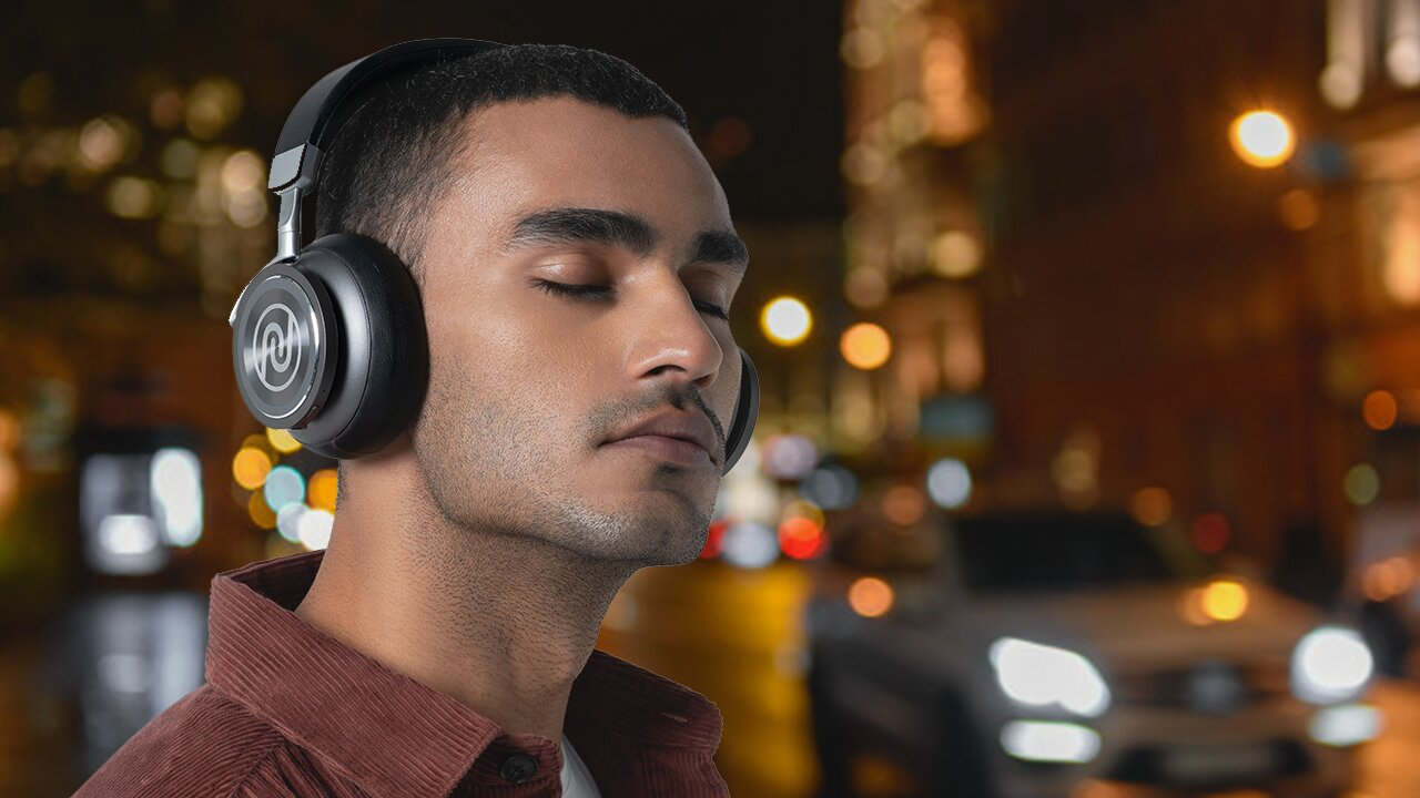 Man wearing Noise Defy headphone with active noise cancellation