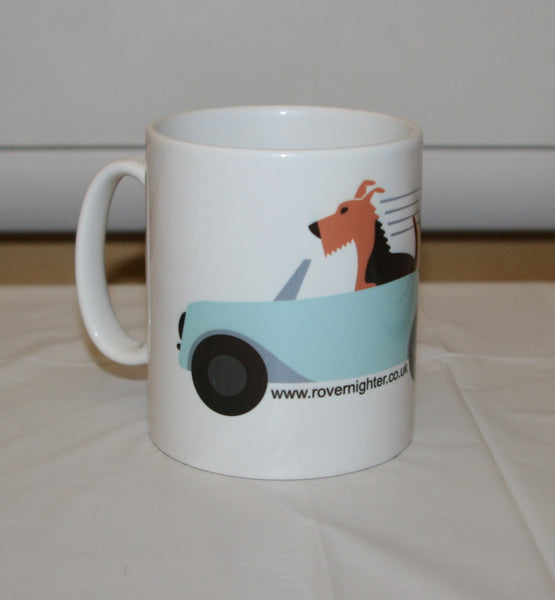 Side view of a mug featuring Bronwyn the dog in a convertable car
