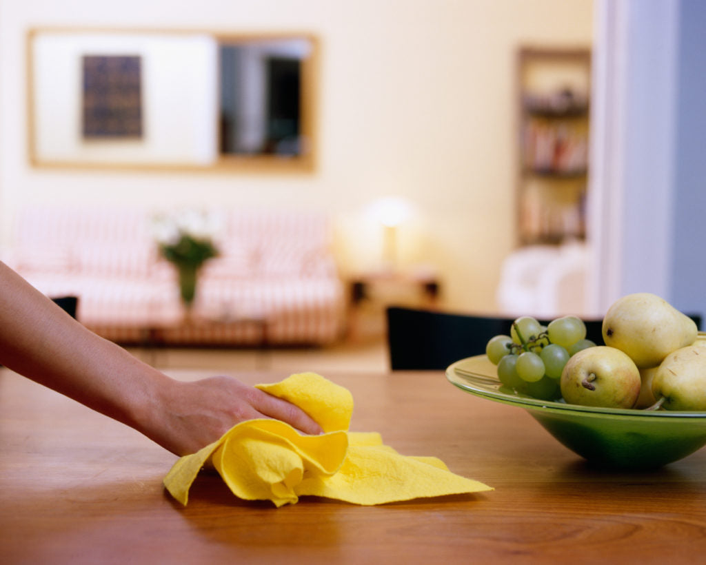 Housewife cleaning dining table