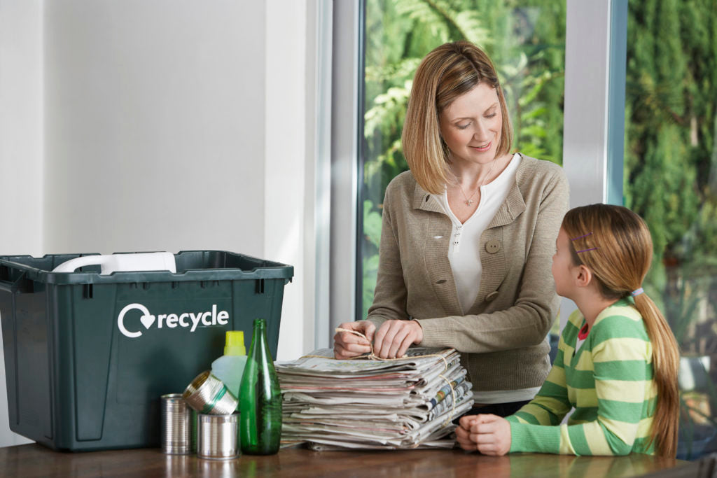 Mother and Daughter Recycling Household Waste