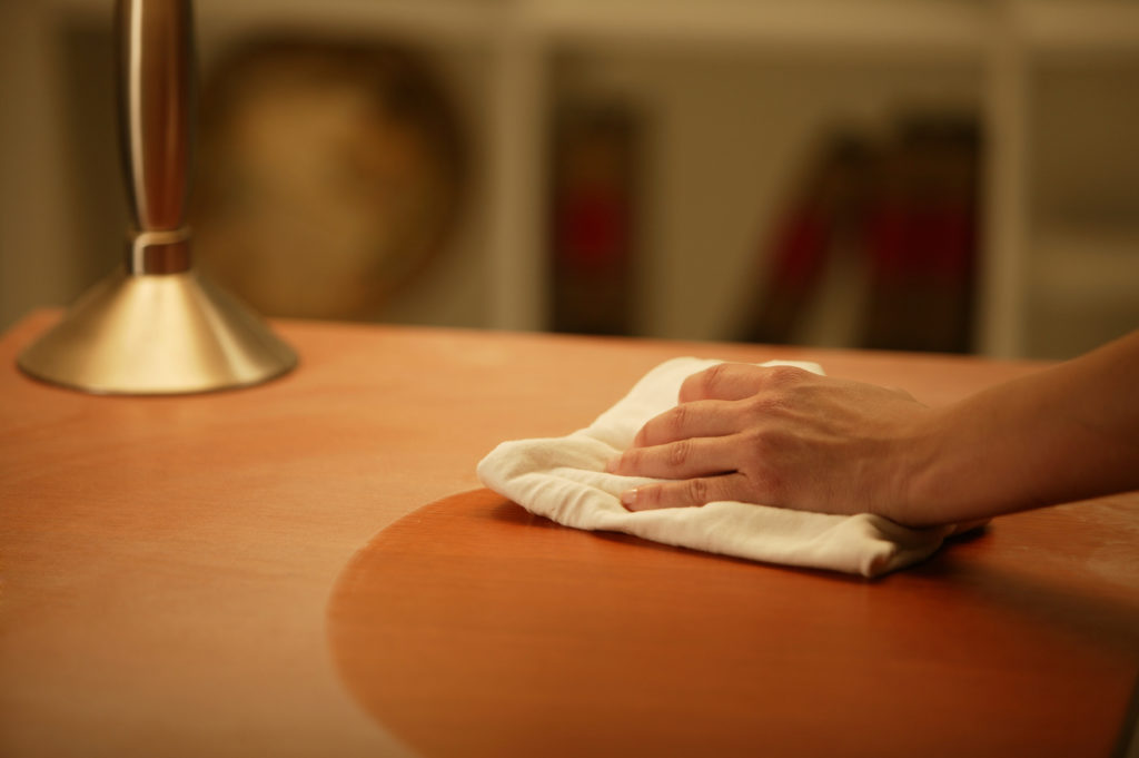 Person wiping table