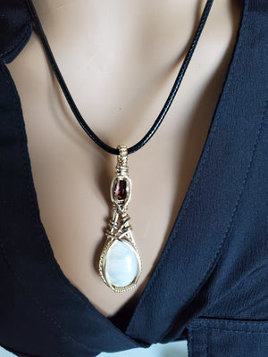 Chatoyant Pearl Shell  w/ Garnet Pendant in 14kt gold filled wire