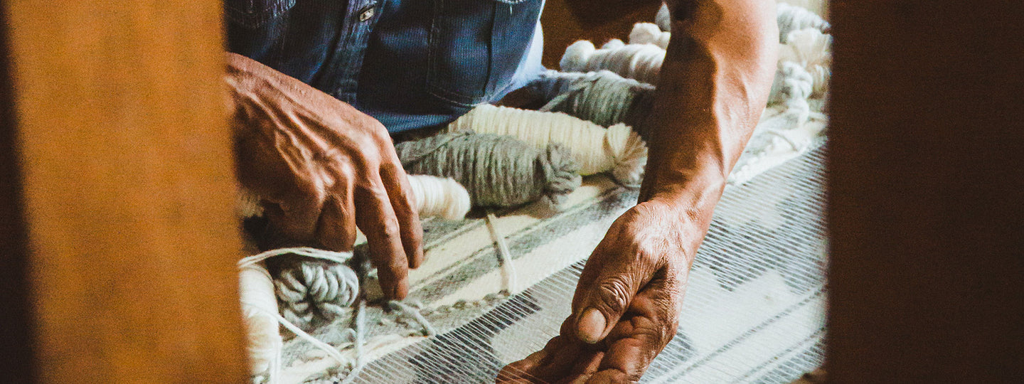 Artisan making a rug on a loom