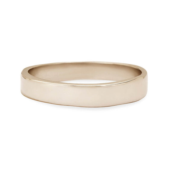 Karen Karch jewelry's Always men's wedding band in 18k white gold with a classic polished surface yet maintains its individuality with a subtly irregular rounded edge.