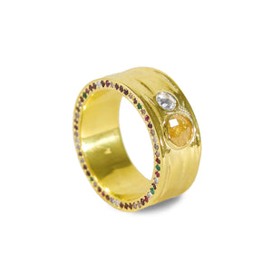 A Rose Cut Yellow Diamond, representing the Sun, a diamond representing the Moon, are set into this Out-of-the-ordinary and Out-of-this-word Yellow Gold men's wedding band. Studded with a random mix of colorful gems and diamonds. This One-of-a-kind band is made by New York's best custom jewelry designer, Karen Karch. Visit our Gramercy store or explore our previous custom designs at www.karenkarch.com!