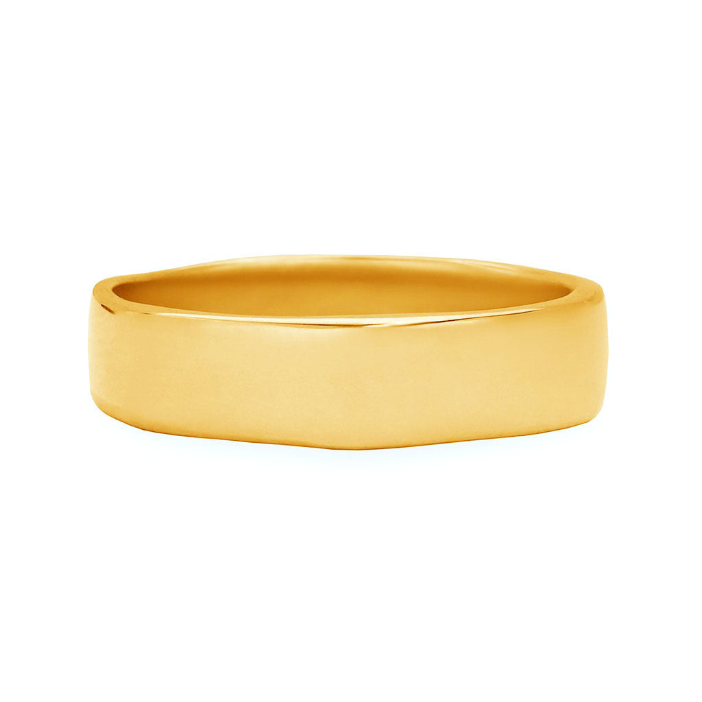 "Made local in Manhattan by New Yorks best alternative jewelry designer, Karen Karch, our Men's yellow gold ""Timeless"" ring sparks originality with an irregularly shaped wedding band that appears traditional from afar but contains a unique character resembling the wearers individuality. Popular design for alternative men. hop our store located a few blocks away from Gramercy Hotel or visit www.karenkarch.com to see more."